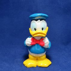 Vintage Donald Duck Candle Holder/ Disney Character/ Taper Candle/ Collectible/ Cake Topper by TwoCousinsCollection on Etsy