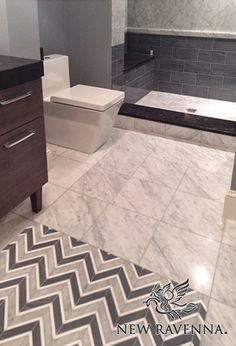 Raj, a stone waterjet mosaic, is  shown in Driftwood, Thassos and Heavenly Cream.<br /> -photo courtesy of Fine Line