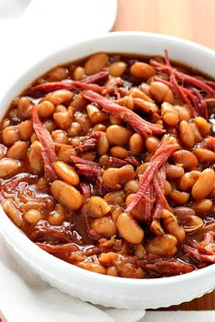 Slow Cooker Baked Beans - comfort food classic made easy in the slow cooker with just a few ingredients! Use a leftover ham bone or bacon. This recipe is a family favorite!