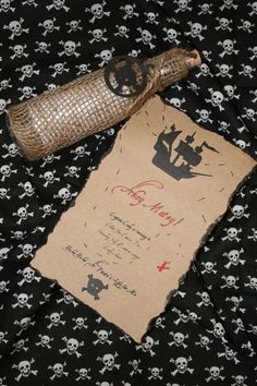 Pirate treasure map invitation. The bottle inspired me to make a telescope that looks similar.