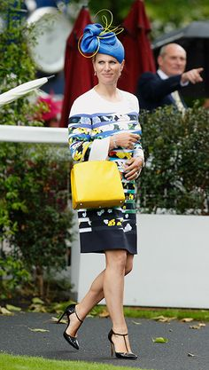 Zara Tindall The eldest granddaughter of Queen Elizabeth—and an Olympic equestrian—is as fierce in fashion as she is on horseback. She loves a chic hat/purse combo, but this colorful Mary Katrantzou dress moment at Royal Ascot is one of her style bests. Royal Tiaras, Royal Crowns, Royal Jewels, Zara Phillips, Estilo Real, Isabel Ii, Fancy Hats, Royal Princess, Royal Ascot