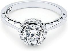 Tacori 6 Prong Halo Diamond Engagement Ring  : Let this brilliant round diamond take center stage! The aerial perspective of this luxurious piece reveals the true beauty of this stunning design. The balance between the high-polished ceiling and the unique spotlight diamonds that light up your choice of a center stone, create a truly harmonious engagement ring. The inner face is delicately detailed with our sculpted crescent design.
