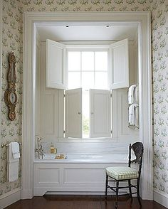cozy nook for this tub; love the shutters so you can open to peek at the view.  G.P. Schafer Architect