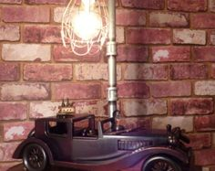 "VINTAGE ROADSTER - ""PROHIBITION"" ~  Very cool Vintage Roadster Lamp. Vintage Wooden Model Roadster, parked under the streetlight loading up the ""HOOCH"", to take on the next booze run. Roadster, Hooch, Steampunk Lamp, Pipe Lamp, Vintage Lamps, Home Appliances, Cool Stuff, Shop, Model"