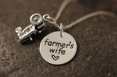 Custom Hand Stamped Farmer's Wife Necklace sterling silver with tractor charm. $46.50, via Etsy.