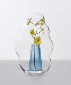 Placed over the flower- or plant-filled vase by an opening at its base, the Bubble hoods contain enough air to maintain a level of humidity inside the dome to make its contents last longer. Mochi Cake, City Resort, Solid Shapes, Flower Vases, Flowers, Paris Design, Glass Vessel, Dezeen, Visual Effects