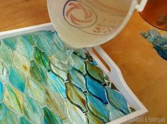 Add tiles or broken china to the bottom of an old tray and just add epoxy! {Sawdust and Embryos}