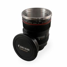Lightweight plastic mug designed to look and feel just like a camera lens. Made of stainless steel to keep your beverage warm. Mug comes with a cap that acts as a leak-proof lid for when traveling.