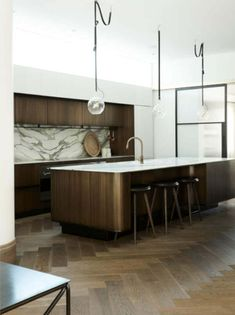 Contemporary Kitchen with dark wood cabinets and white marble with lots of vein with herringbone walnut floor and steel doors and windows steeldoorsandwindows Dark Wood Kitchen Cabinets, Bronze Kitchen, Dark Wood Kitchens, Walnut Cabinets, Kitchen Flooring, Wood Interior Design, Interior Exterior, Kitchen Interior, Architecture Design