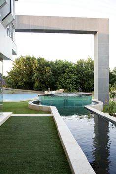 Glass House by Nico van der Meulen Raised circular spa with acrylic wall. Pinned to Pool Design by Darin Bradbury.