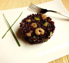 La ricetta del riso venere con scampi marinati