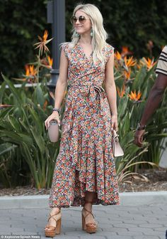 What a beauty:The 29-year-old wowed in her floral patterned dress, adding sky high lace u...
