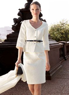 White pencil slim skirt suit with decorative buttons and attractive sparkle