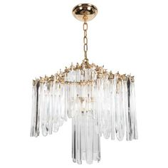 A Mid-Century Modernist chandelier by Lobmeyr featuring a three-sided pagoda design surrounding a central lower tier. The crystals are elongated an. Mid Century Modern Chandelier, Chandelier Pendant Lights, Chandeliers, Candelabra Bulbs, Gold Wood, Modern Lighting, Mid-century Modern, Plating, Ceiling Lights