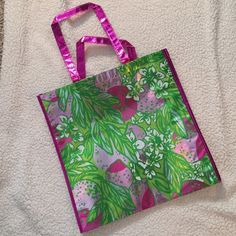 Lily Pulitzer tote Never been used. Measures 15 1/2 inches tall and 16 inches wide. Lilly Pulitzer Bags