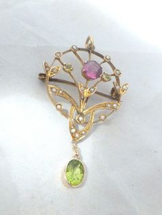 9ct/9k gold Victorian Art Nouveau Peridot, Seed Pear and Amethyst pendant/brooch