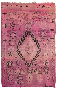 Moroccan rugs, known for their geometric designs and either monochromatic or richly colored palettes, are popular among designers who visit Woven Accents.