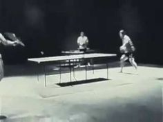 Bruce Lee (A very famous martial artist) playing ping pong with nun chucks.
