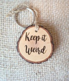 Keep It Weird Keychain, Keyring, Rustic Key Holder, Wood Slice Keychain Keyring, Key Ring, Engraved Gift, Weird Gift, Keys, Wood Keyring by SweetHomeWoods on Etsy https://www.etsy.com/listing/461201266/keep-it-weird-keychain-keyring-rustic