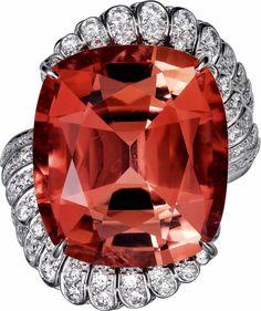 CARTIER. Ring - platinum, one 35.06-carat cushion-cut cognac tourmaline, pink garnets, brilliant-cut diamonds.