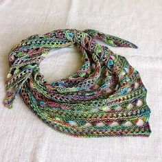 Golden Filigree by Tetiana Otruta, pattern available on Ravelry. This version knit in Malabrigo Arroyo, color Arco Iris.