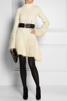 Alexander McQueen's thickly knit wool and #mohair dress is perfect for transitioning from desk to dinner during the cold months. This cream style features ribbed and plush textures for a cool dégradé effect. Accentuate the fit-and-flare shape with a chunky belt. Shown here with: Maria Black earrings, Bottega Veneta rings, Jimmy Choo belt, Falke tights, Lanvin boots, Valentino clutch.