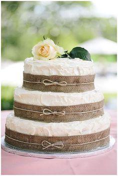 hessian wedding ideas wedding cake with burlap ribbon around layers