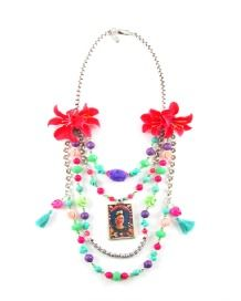 FLOWERING FRIDA NECKLACE  Full of fun, this multirow candy coloured necklace will never go unnoticed. Bright flowers, in full bloom sit either side of graduating beaded strands. The beads are a mix of glass in smooth and faceted shapes. There are accounts of howlite skulls and carved resin flowers. In the centre of the necklace is a framed hand painted picture of Frida Kahlo. This necklace is a tribute to her and her works. Resin Flowers, Bright Flowers, Candy Colors, Strands, Skulls, Centre, Crochet Necklace, Bloom, Smooth