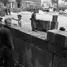 East German build cinder block wall in East Berlin as the divided city continued in stage of unrest August 18, 1961. (AP Photo)PA-92755201