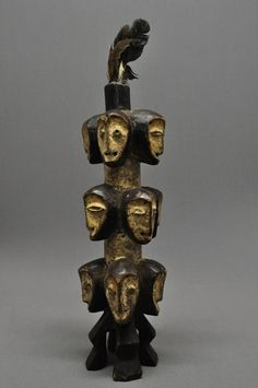Africa   Lega multi-faced ancestor carving is from the Congo. It is wood with white pigment and feathers. Each face is carved depicting a different representation