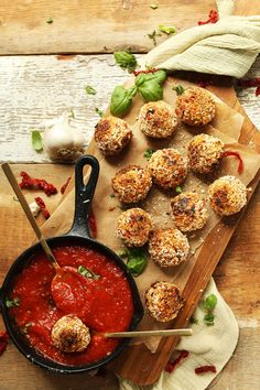 10-ingredient vegan arancini with cauliflower rice, sun-dried tomatoes, and basil. A healthier twist on the Italian classic cheese-stuffed rice balls.