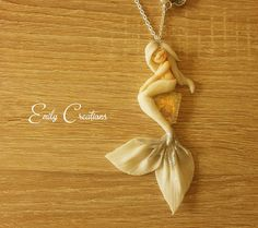 Beautiful romantic and sweet necklace with white mermaid in