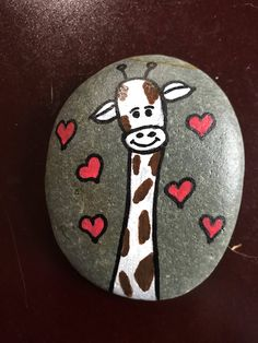 A personal favorite from my Etsy shop https://www.etsy.com/listing/576238854/giraffe-painted-rock
