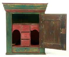 "Garth's Sale 1139 11/27/15. Lot 159 (inside).    Estimate $400-800.    Sold for $1,200.    DECORATED HANGING CUPBOARD.  Possibly Pennsylvania, dated 1825, pine. Raised-panel door, the interior with drawers and pigeonholes. Retains old red and green paint with initials ""NCSW."" 31""h. 27""w. 14""d.    Previously sold at Garth's, likely in the 1990s."