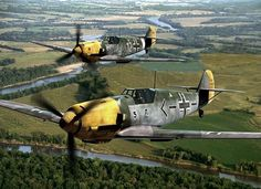 "Two Bf-109s in flight during World War II. This plane was also known as a Messerschmitt (hence ""Me-109""), but the manufacturer was the Bayerische Flugzeugwerke (""Bavarian Aircraft Works""), hence ""Bf-109""."