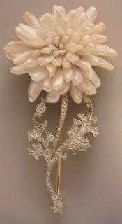 Freshwater pearls are the flower petals on thie Chrysanthemum brooch by Paulding Farnham.  He was a top jeweler in the Golden Age of Tiffany and Company, during the end of the 19th and beginning of the 20th centuries.