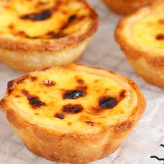Portuguese egg tarts - buttery, flaky and crispy crust with smooth and soft custard filling.