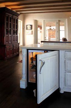 Under-counter bev fridge.  Custom kitchen cabinets by La Puerta Originals