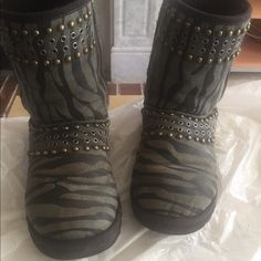 Authentic UGG JIMMY CHOO sz7 Used in a ok condition authentic uggs jimmy choo collection. Blue/grey zebra collection. See the pic for condition, maybe 5 studs are missing, or 6. Priced as is. UGG Shoes Winter & Rain Boots