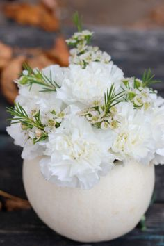 The House That Lars Built.: White pumpkin with white flowers