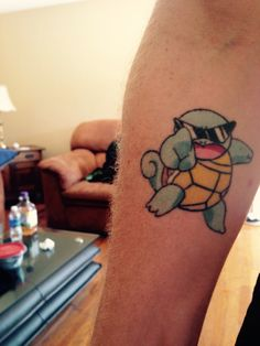 My brother got Ash's Squirtle from Squirtle Squad tattooed on him.