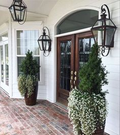 Outside entry front step lime washed brick walkway & lantern lights