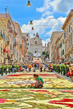 Genzano di Roma - L'infiorata, a flower festival held in June, Italy.  Photo by Genzano di Roma via Flickr