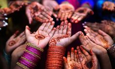 Pakistani Christian girls with painted hands and bangles celebrate Easter holiday in Islamabad.