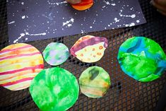 solar system... maybe I will be adventurous enough to let my 20 lovies paint planets. These look so cute!