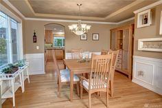 Bright and lovely hard wood dining room with coved ceiling between living room and kitchen. 8522 NE 128th St, Kirkland , 98034