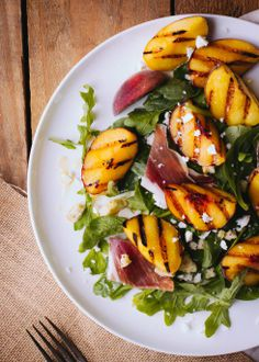 Grilled Peach and Rocket Salad with Honey Lemon Dressing from inspiredfood.net A great light salad!