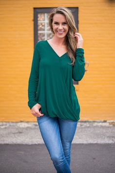 I have this top. It looks cute with a scarf or pretty necklace and cardigan.