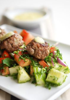 Lamb Kofta Salad...made a few changes because I didn't have certain ingredients: used lime instead of lemon, added 1 tsp oregano, 1 tsp cayenne, 1/2 cup bread crumbs and 1 egg to kofta, x-ed the parsley and added avacado and blue cheese to salad soooooo DELISH!!!