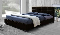 Sleek, contemporary platform bed with slatted base comes with a fully upholstered, padded headboard that makes lounging comfortable